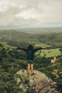 Girl on a Mountain, arms outstretched